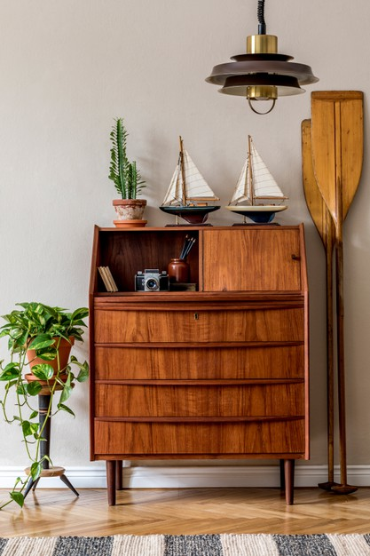 stylish vintage interior design living room with wooden retro commode plants ships paddle map 431307 456